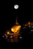 Night scene Kyaikhtiyo Pagoda in full Moon night. Royalty Free Stock Photography
