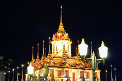 Night scene of Loha Prasat at Wat Ratchanaddaram Woravihara Royalty Free Stock Photo