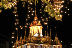 Night scene of Loha Prasat at Wat Ratchanaddaram Woravihara during His Majesty the King's bir Royalty Free Stock Photography
