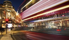 Night scene of London city with moving red bus and cars stock photo