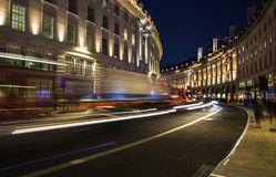 Night scene of London city United Kingdom with the moving red buses and cars stock photos
