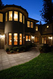 Night Scene of a luxury house. Exterior of an American Luxury Wooden House Royalty Free Stock Photos