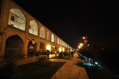 Night scene in Maidan Square Esfahan, Iran. Naqsh-e Jahan Square in Esfahan, groups of youngs and famillies in Maidan Square, bazar area Stock Image