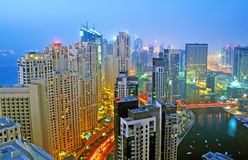 Night Scene of Marina. A high level view of a night scene of Jumeirah Beach Residence and Dubai Marina with trailing lights on the road royalty free stock images