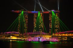 The night scene of Marina Bay on new year eve. The colorful night panorama of the commercial and business district of Singapore on the new year eve. The picture Stock Photography