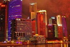 The night scene of Marina Bay on new year eve. The colorful night panorama of the commercial and business and financial district of Singapore on the new year eve Royalty Free Stock Photos