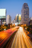 night scene of modern city. Building and light trail on road wit Royalty Free Stock Image