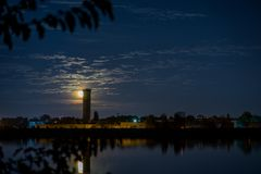 Moon rising over city. Night scene with moon rising over city stock images