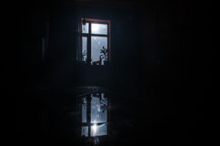 Night scene of moon seen through the window from dark room Royalty Free Stock Photography