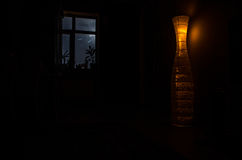 Night scene of moon seen through the window from dark room. Moonlight inside dark room Royalty Free Stock Photography