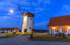 Windmill in Moravia Czech Republic. Night scene with Moon by the windmill royalty free stock photos
