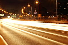 Night scene of motion blurred. Light tracks glowing to the darkness of highway traffic to the city just after sunset Royalty Free Stock Photography