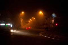 Night scene with moving carsand walking people Royalty Free Stock Photography