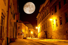 Night scene in old city. Night scene with big moon in old city Stock Photo