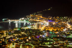 Night scene panorama of city at sea in Montenegro Royalty Free Stock Photography