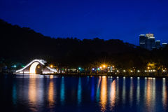 Night scene of a park with a traditional bridge Royalty Free Stock Photography