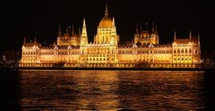 Night scene of Parliament in Budapest. Night scene of Parliament building and Danube river in Budapest from Buda embankment Royalty Free Stock Photo