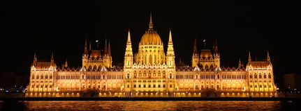 Night scene of Parliament in Budapest. Night scene of Parliament building and Danube river in Budapest, front view Stock Photo