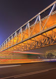 Night scene with pedestrian bridge and traffic in motion blur, Beijing, China Stock Image