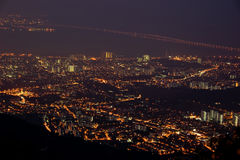 Night scene of Penang Island. Night view of cityscape with sea view and bridge in Penang Royalty Free Stock Photo