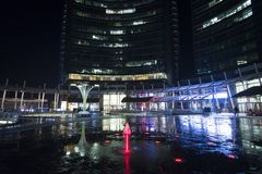 Night scene from Milan Gae Aulenti square. Night scene from one of the new and most popular district in Milan named Piazza Gae Aulenti royalty free stock photos