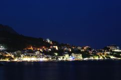 Night scene of Podgora with Biokovo mountain Stock Photo