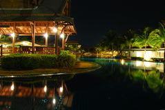Night scene of pool and village Royalty Free Stock Photo
