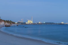 Night scene of Power plant with bay Stock Images