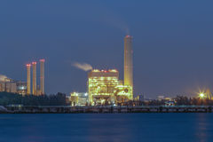 Night scene of Power plant with bay Royalty Free Stock Images