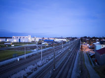 Night scene railroad and industrie buildings. Night scene of railroad tracks and industrie buildings of a small village in Germany stock image