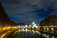 Night scene of Rome, Tevere river with basilica in background. Night scene of Rome, Tevere river with Saint Peter basilica in background. Italian landmark italy stock photos