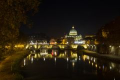 Night scene of Rome, Tevere river with basilica in background. Night scene of Rome, Tevere river with Saint Peter basilica in background. Italian landmark italy royalty free stock image