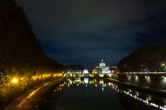 Night scene of Rome, Tevere river with basilica in background. Night scene of Rome, Tevere river with Saint Peter basilica in background. Italian landmark italy stock photography