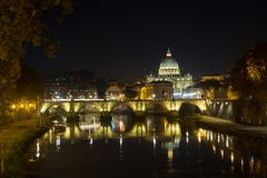 Night scene of Rome, Tevere river with basilica in background. Night scene of Rome, Tevere river with Saint Peter basilica in background. Italian landmark, italy stock photos