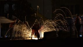 Night scene showing railway night workers surrounded by sparks royalty free stock image