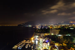 Night scene of Sorrento. The pier with lots of yachts, a corner of the cityscape on a summer night, Amalfi coast, Italy Royalty Free Stock Image