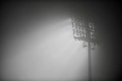 Night scene with stadium floodlights in fog Stock Images