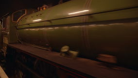 Night Scene of a Steam Train Pulling Off at Victoria Station in London stock video footage