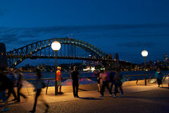 Night scene in Sydney. People walking at the promenade in Sydney ay night Royalty Free Stock Images