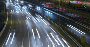 Night scene of traffic and roads.Time Lapse - Long exposure - 4K. (6). Night scene time lapse traffic and roads top and front view, of entry and exit of stock video footage