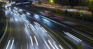 Night scene of traffic and roads.Time Lapse - Long exposure - 4K.(5). Night scene time lapse traffic and roads top and front view, of entry and exit of Barcelona stock footage