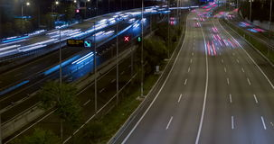 Night scene of traffic and roads.Time Lapse - Long exposure - 4K. (10). Night scene traffic and roads, top and rear view of entry and exit of Barcelona.Time stock footage