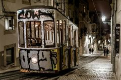 Narrow Trolley in the Streets of Lisbon, Portugal. Night scene of trolley in Lisbon, Portugal Stock Photo