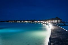 Night scene of typical luxury overwater villa. In Maldives stock photos