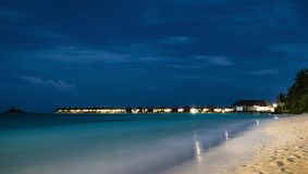 Night scene of typical luxury overwater villa. In Maldives stock photography
