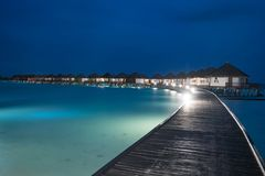 Night scene of typical luxury overwater villa. In Maldives stock image
