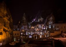 Night scene of the Uchisar Castle in Cappadocia. Illuminated view of famous Uchisar village, district of Nevsehir