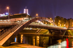 Night scene of Vilnius. Gediminas Castle and lights reflected in river Neris stock photo