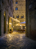 Night scene in Volterra. With narrow alley and restaurant Royalty Free Stock Photography