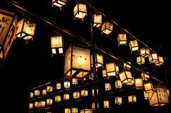 Night scene of votive lanterns at Japanese temple Stock Image
